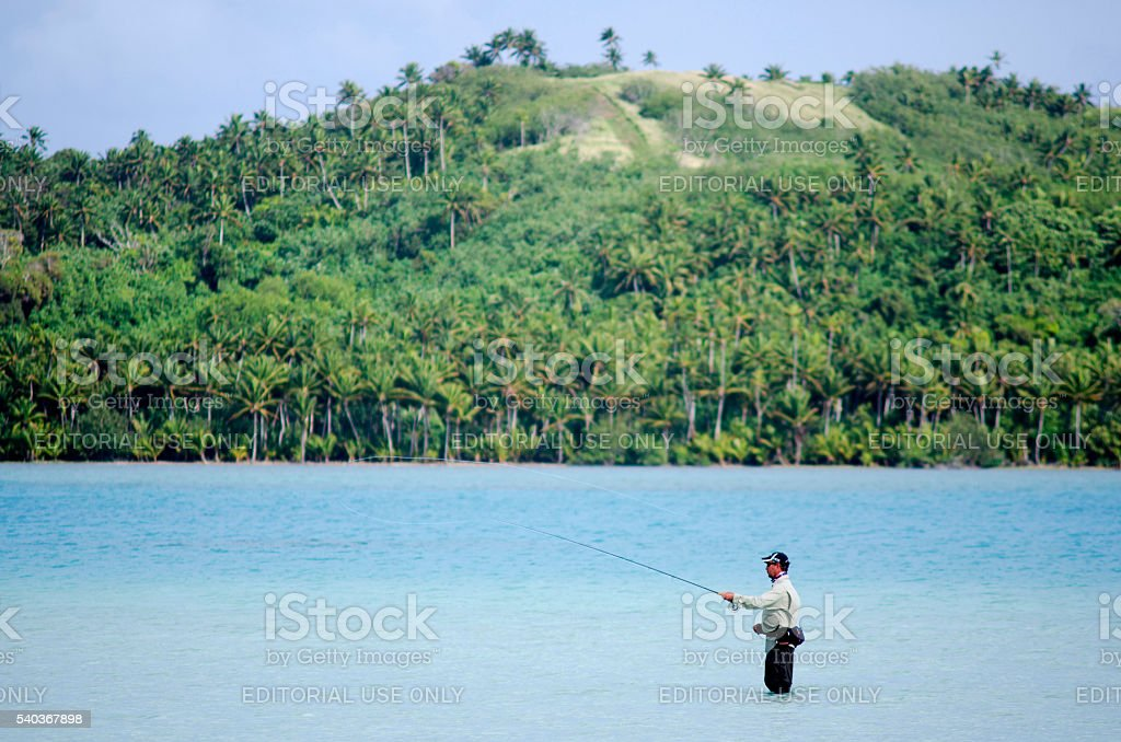 Casting for bonefish in Aitutaki Lagoon Cook Islands stock photo