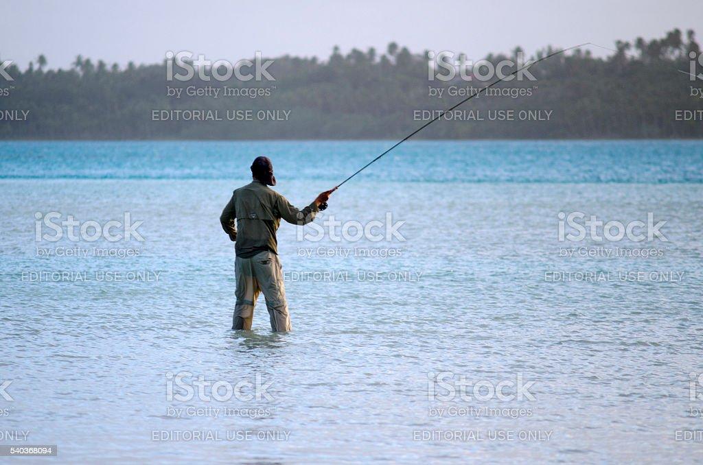Casting for bonefish in Aitutaki Lagoon Cook Islands stock photo