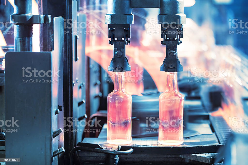 Casting glass bottles stock photo