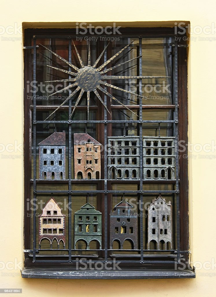 Cast-iron grate on the window royalty-free stock photo