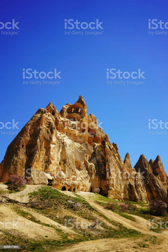 Castle and unique geological formations in Cappadocia stock photo