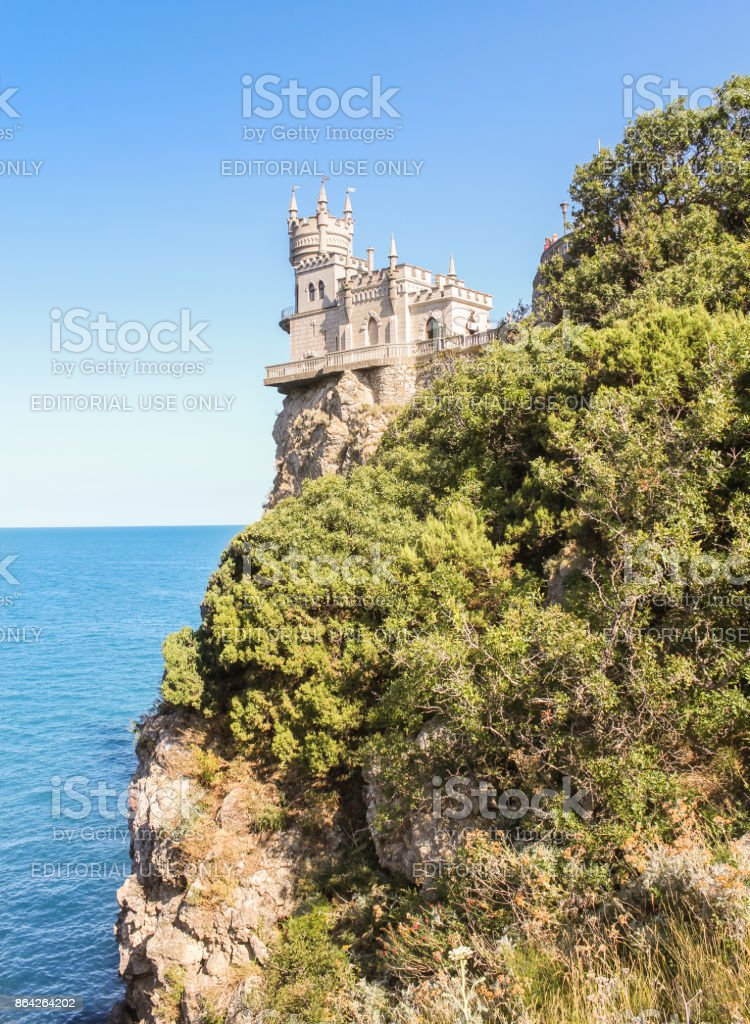 Castle behind a wooded rock. royalty-free stock photo