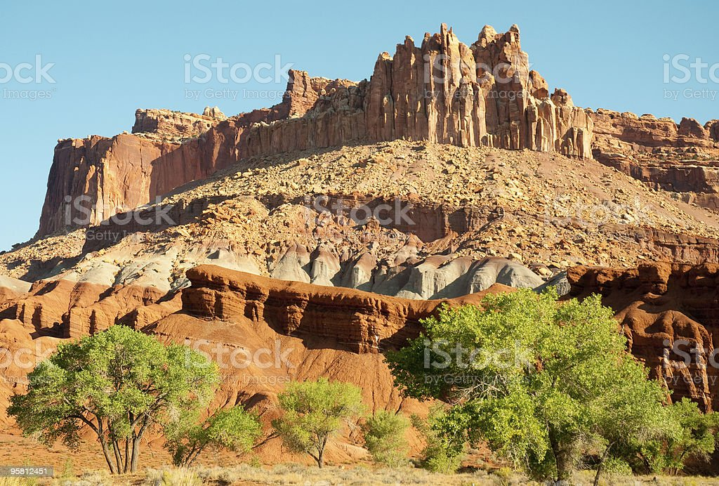 Castle butte rock formation and desert oasis stock photo