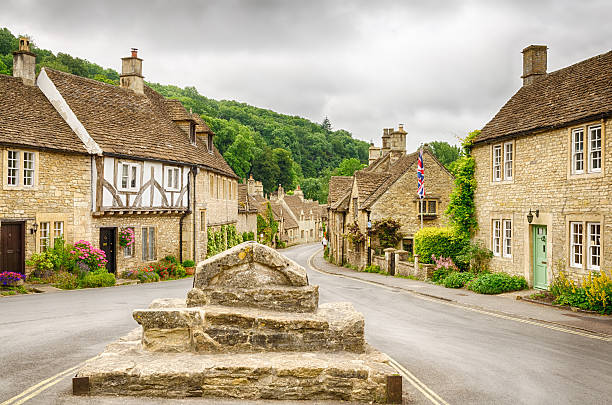 Castle Combe, Cotswold village Historic houses in the Cotswold village of Castle Combe, described as the prettiest village in England and a major tourist destination close to the city of Bath and Stonehenge. somerset england stock pictures, royalty-free photos & images