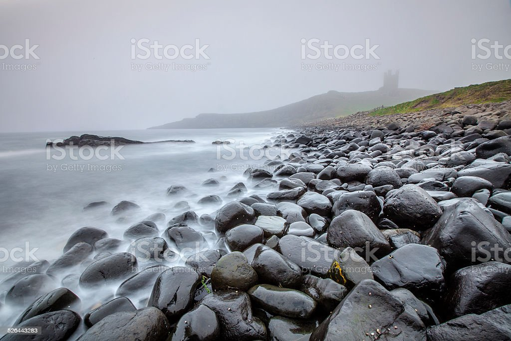 Castle in fog stock photo