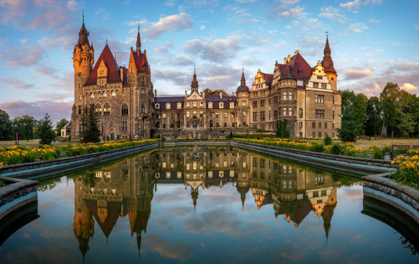 Castle in Moszna in the rays of the rising sun