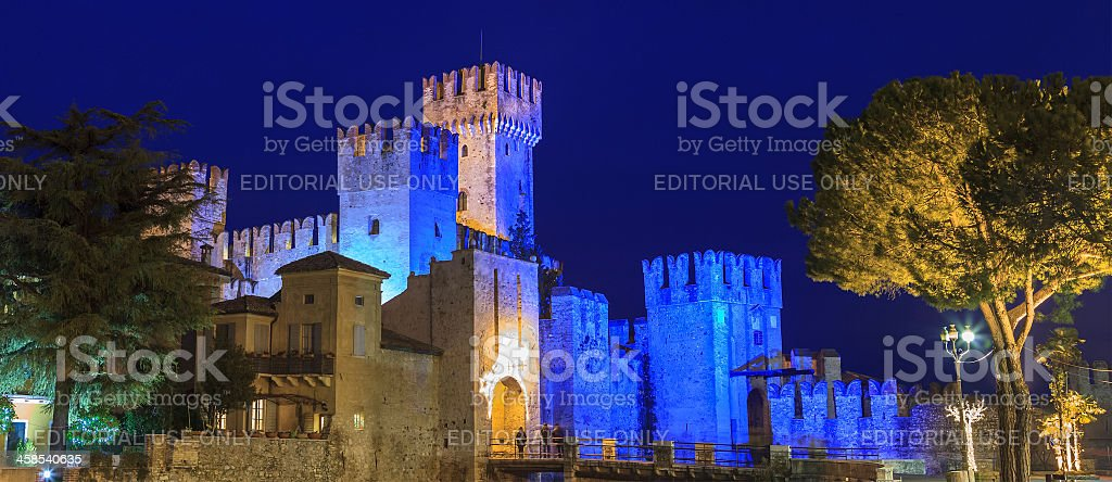 Castle Lit Up in Blue, Sirmione, Italy stock photo