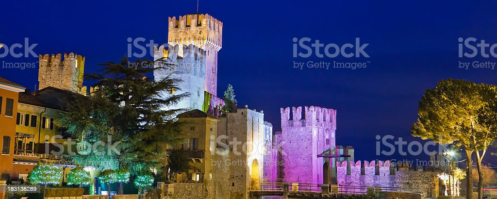 Castle Lit Up in Pink, Sirmione, Italy stock photo