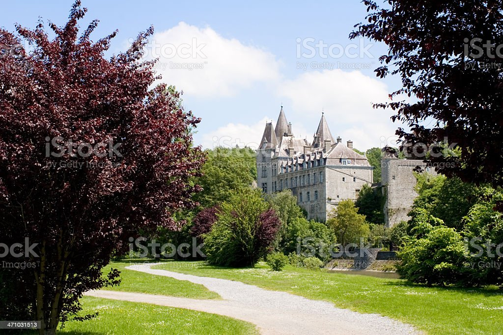 """Castle of Durbuy with surrounding park View of the Castle of Durbuy, the smallest city of Europe, along the river Ourthe. Durbuy was assigned the status of """"city"""" in 1331, with a population of about 400 people. The castle was originally built in the 9th century. Ancient Stock Photo"""
