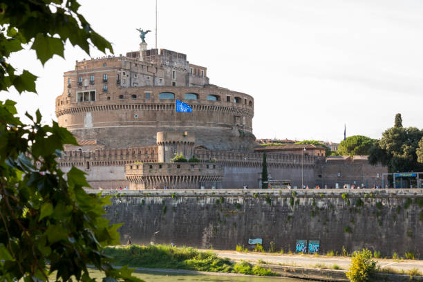 castle of the holy angel - an architectural monument on the banks of the tiber in the center of rome - rome road central view foto e immagini stock