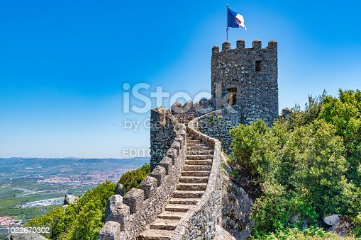 The Castle of the Moors located in the town of Sintra, near Lisbon. Photo taken during a hot summer day and contains some tourists visiting the castle.