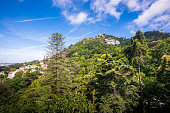 The Castle of the Moors is a hilltop medieval castle located on the mountains of Sintra, Portugal. Shot from Regaleira Tower within the gardens of Quinta da Regaleira.