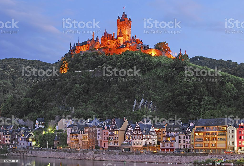 Castle on a hill with town next to Mosel River, Germany stock photo