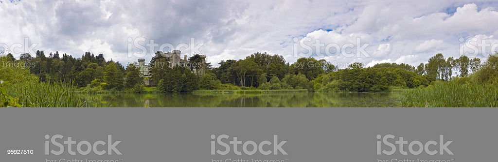 Castle reflected tranquil lake stock photo