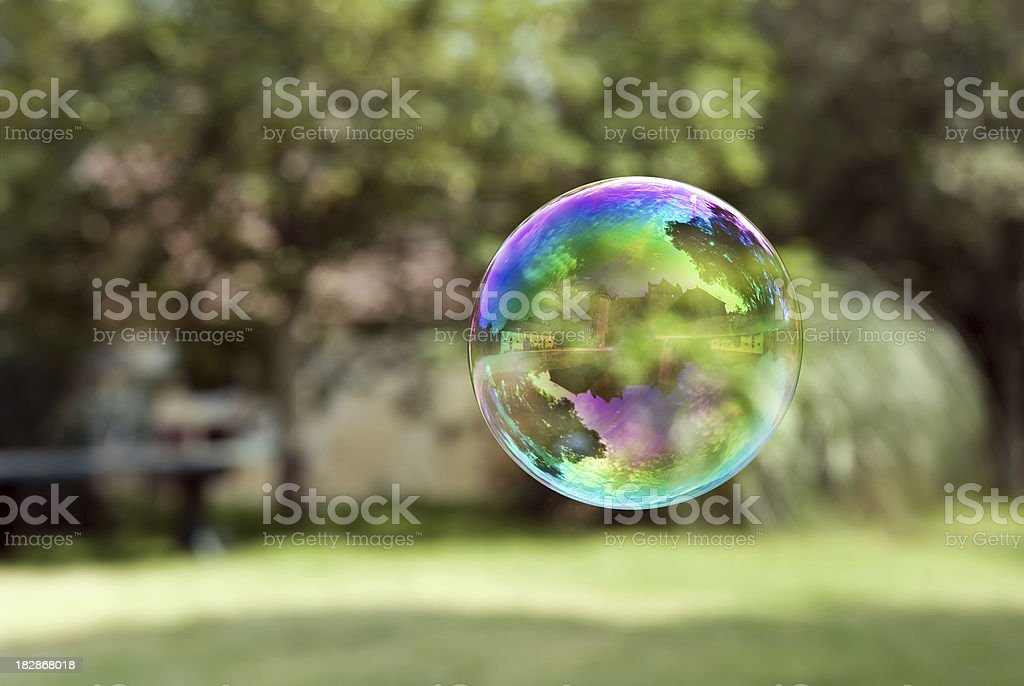 Castle reflecting in flying  a soap bubble stock photo