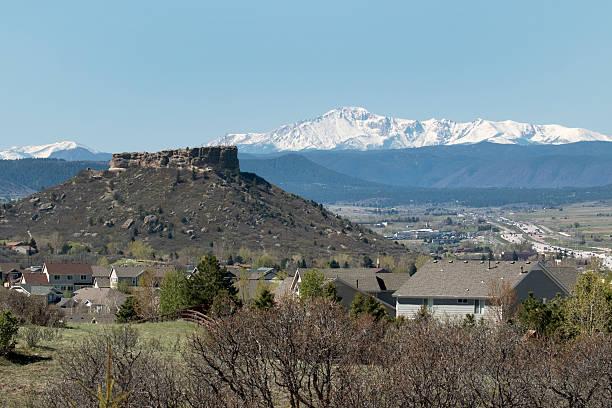 Castle Rock homes Colorado highway snowy Pikes Peak Rocky Mountains stock photo
