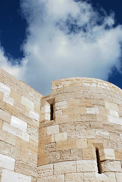 castle tower against deep blue sky stock photo