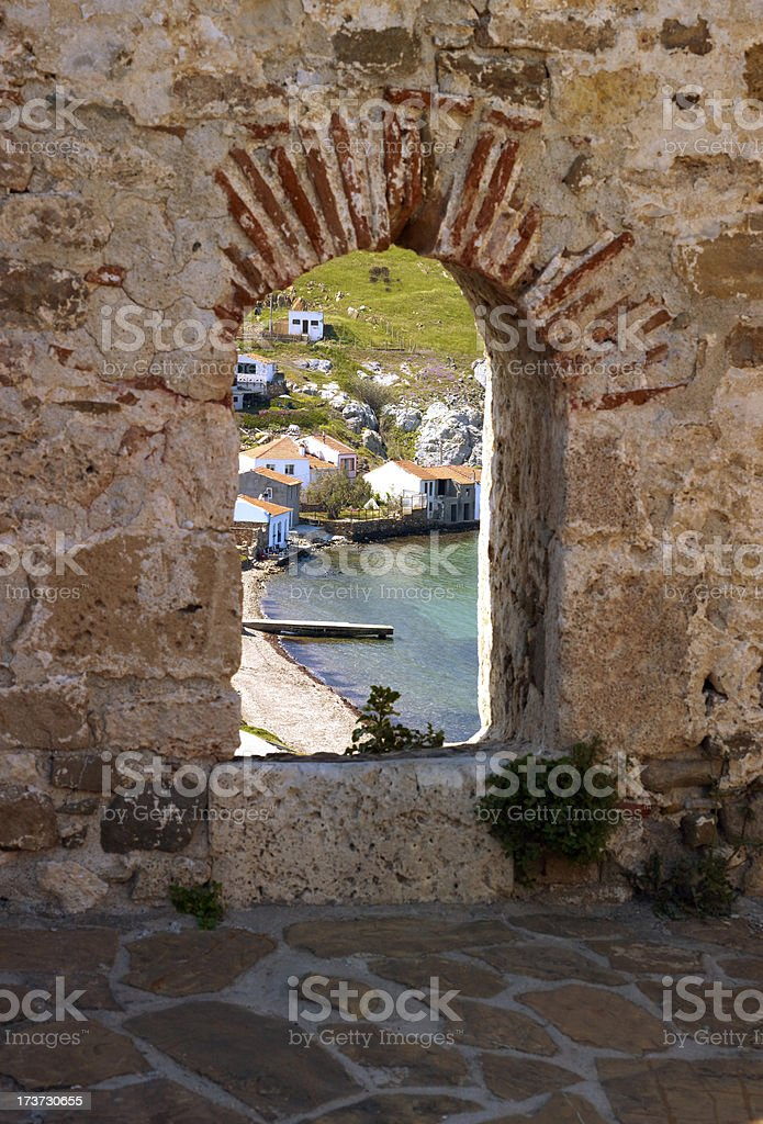 Castle window with city view Bozcaada royalty-free stock photo