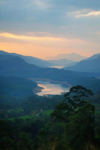 Castlereigh reservoir and surrounded tea plantations in sri lanka stock photo