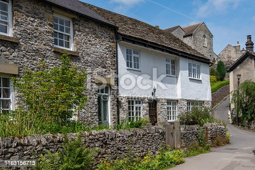 The backstreets and stone cottages in Castleton, Derbyshire, UK