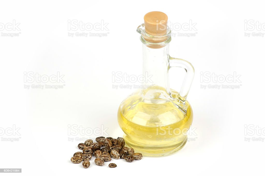 Castor oil is poured into the bottle stock photo