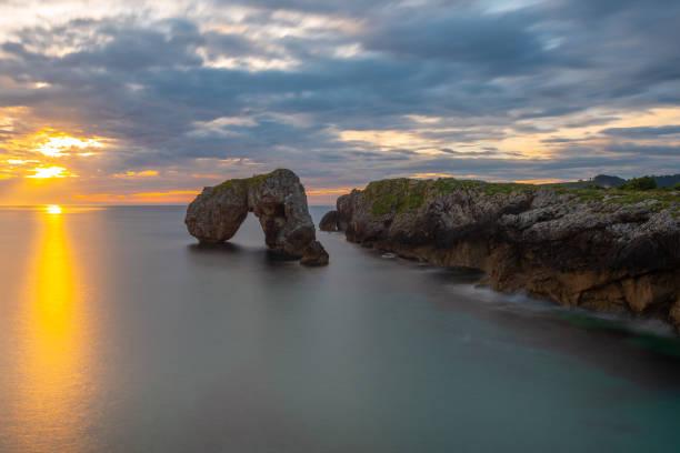 Castro de las Gaviotas rock at sunrise, Asturias, Spain stock photo
