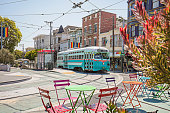 Castro Streetcar with Rainbow Flags in the streets of San Francisco, California, USA.