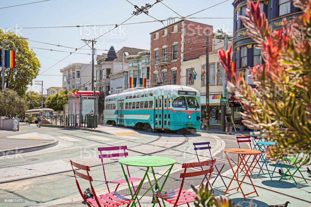 Castro Streetcar with Rainbow Flags in the streets of San Francisco stock photo