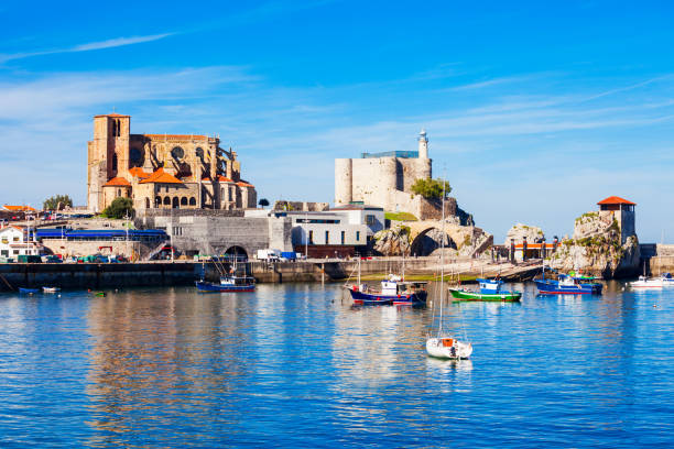 Castro Urdiales city in Spain Boats at the port of Castro Urdiales, Santa Maria Church and Santa Ana Castle Lighthouse in Cantabria region in northern Spain. cantabria stock pictures, royalty-free photos & images