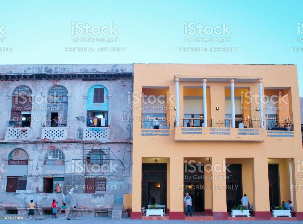 Havana, Cuba - June 21, 2018: Castropol restaurant's renovated facade in contrast to the homes of the inhabitants of Havana stock photo