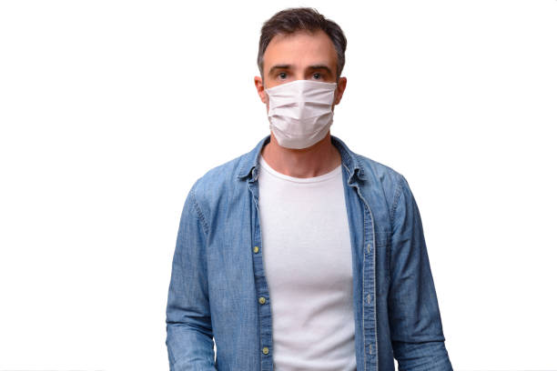 Casual adult man with face mask looking forward isolated stock photo