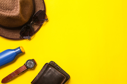 Casual apparel and accessories on a background of yellow paper