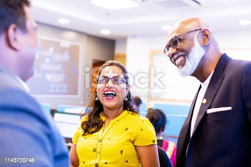 Corporate Business, Indian, Office - Female Business Executive having a casual banter with the senior management team members