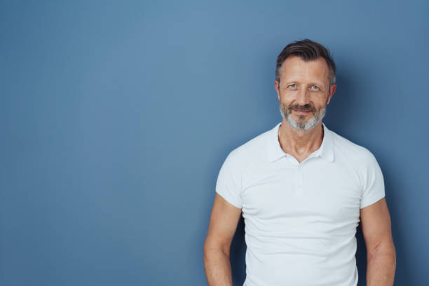 Casual bearded man in a casual white t-shirt stock photo