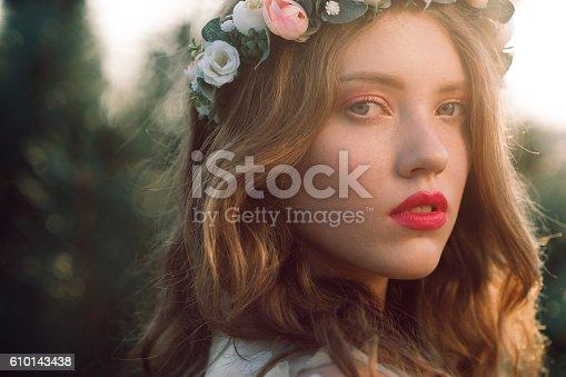 istock Casual bride in wreath close-up portrait 610143438