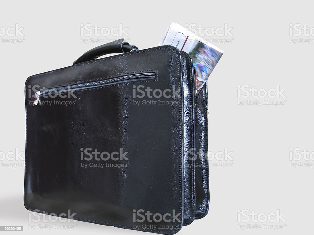 Casual Briefcase and a Newspaper Inside It - Royalty-free Article Stock Photo