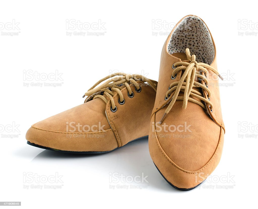 Casual brown leather unisex shoes stock photo