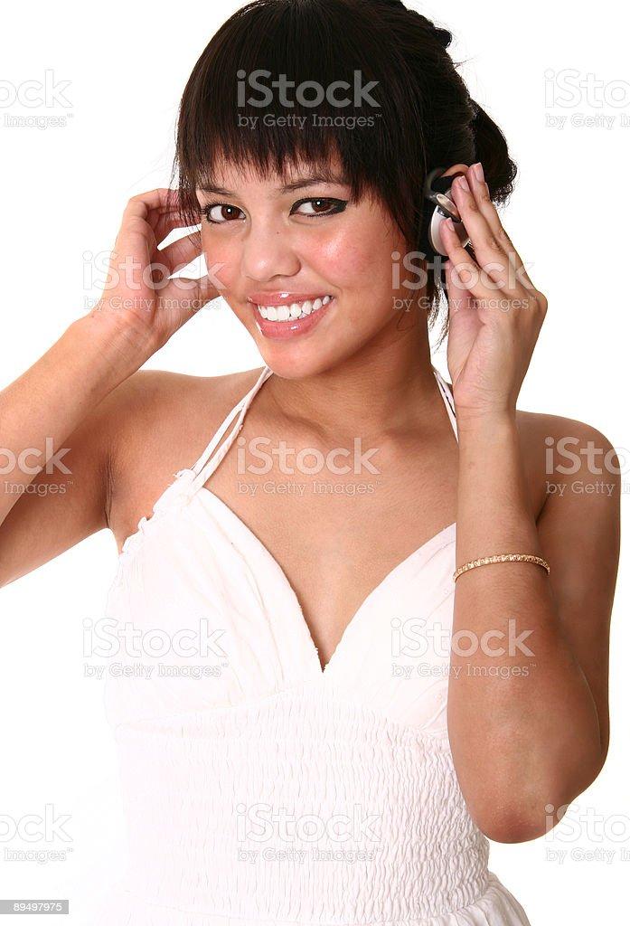 Casual Brunette Listening To Music royaltyfri bildbanksbilder