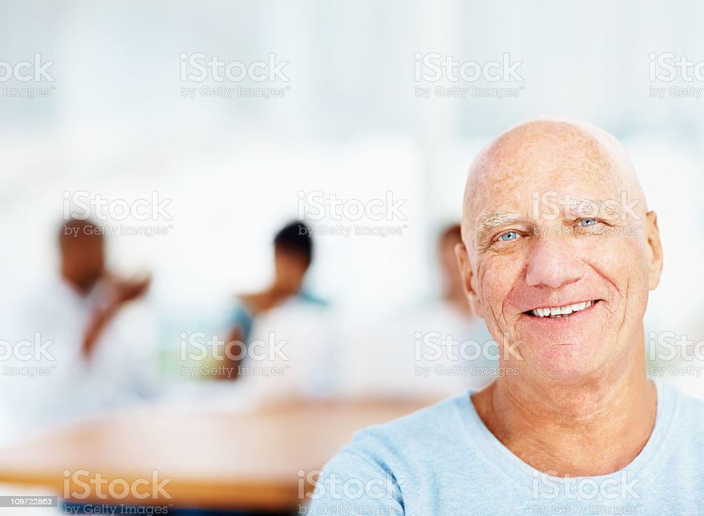 Casual business man smiling and his team in blur royalty-free stock photo