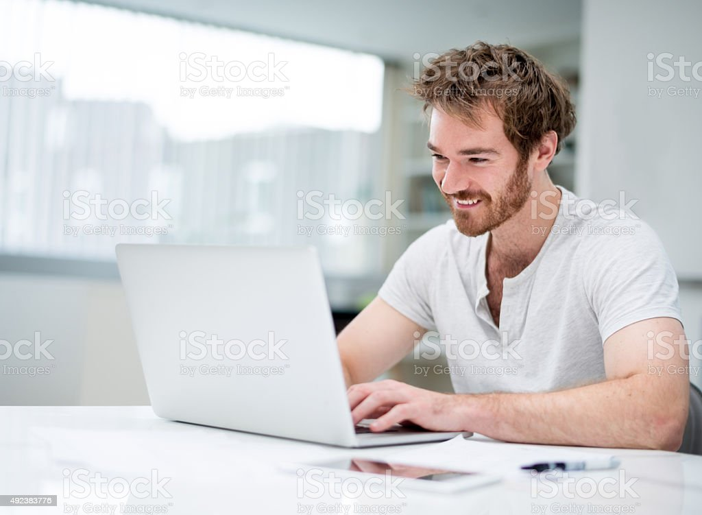 Casual business man working at home stock photo