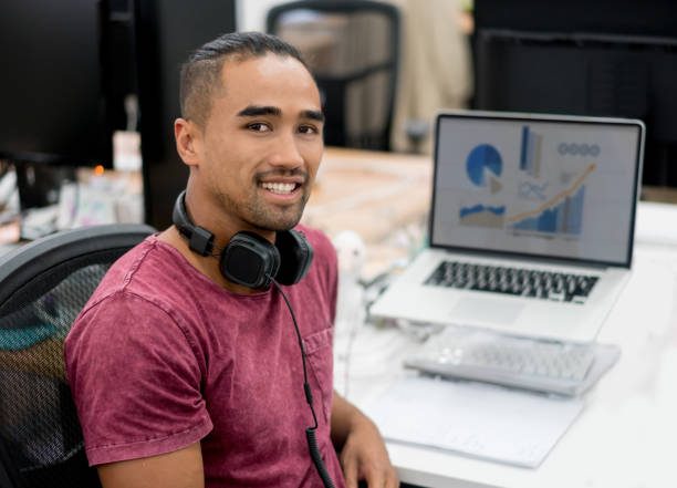 casual business man working at the office - maori stock photos and pictures