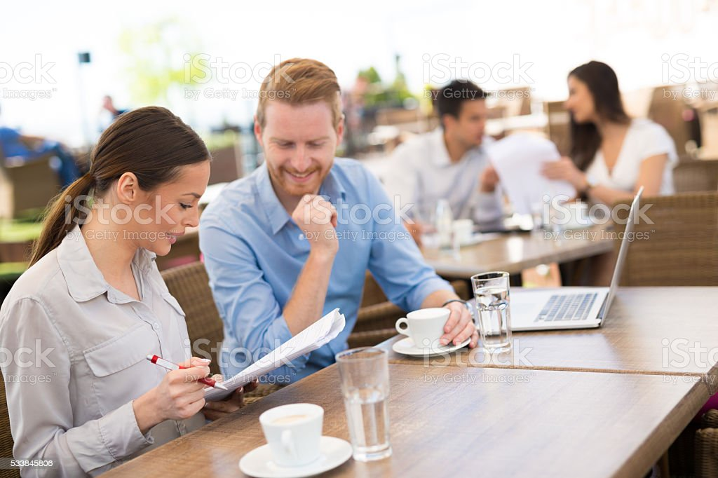 Casual business people at meeting in coffee shop. stock photo