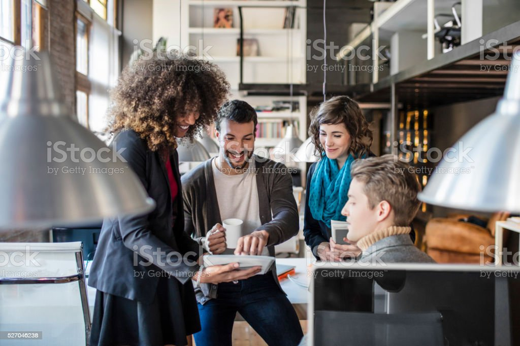 Casual business people talking in meeting at the office stock photo