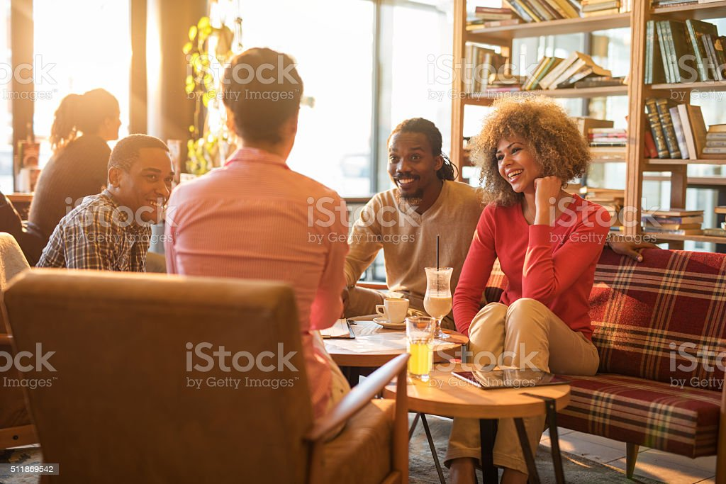 Casual business people talking on a break in a cafe. stock photo