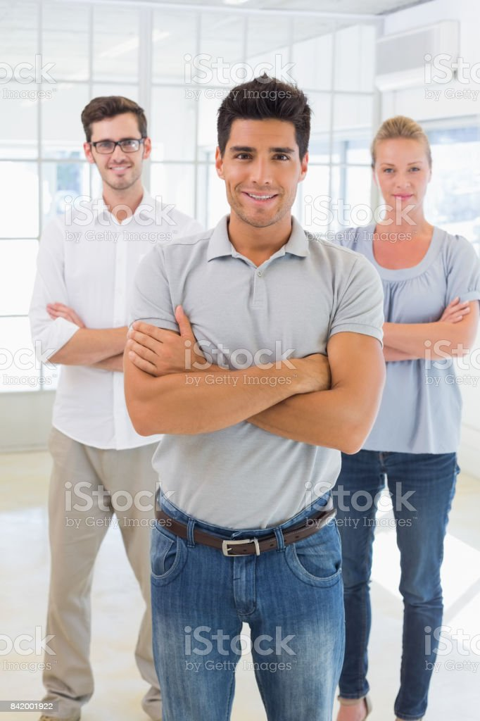 Casual business team smiling at camera stock photo
