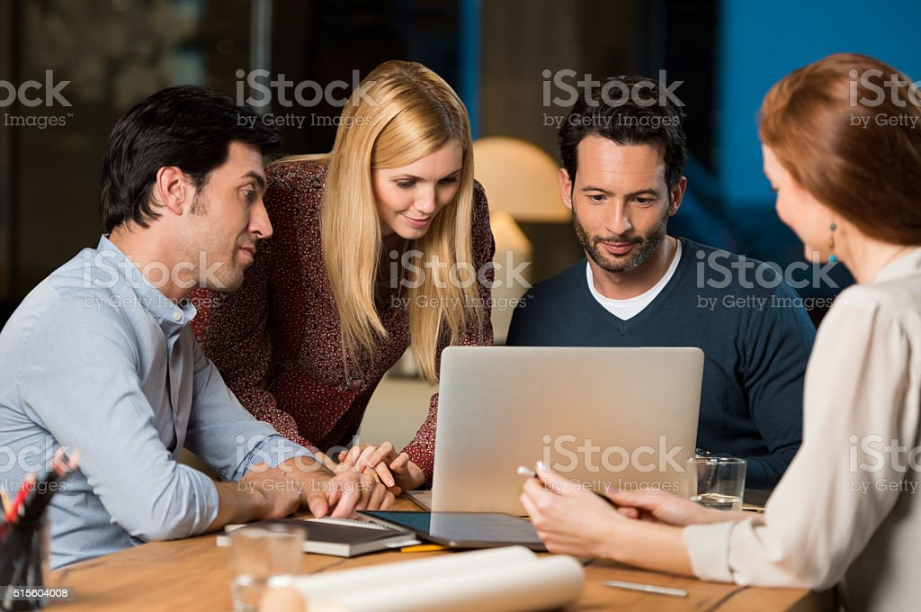 Casual business team working late stock photo