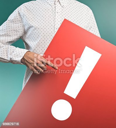 istock Casual businessman holding board with exclamation mark (Click for more) 936629716