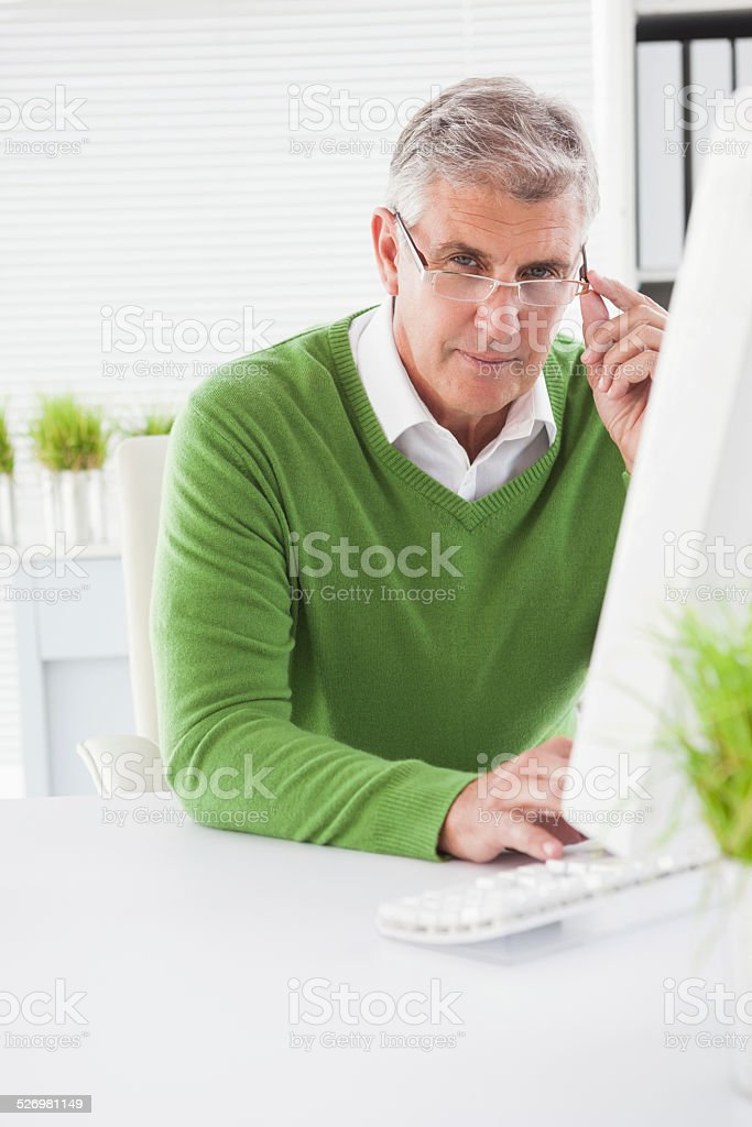 Casual businessman looking at camera stock photo