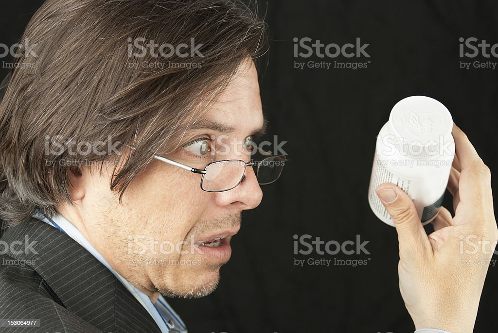 Casual Businessman Looking Over Reading Glasses Trying To Read P royalty-free stock photo