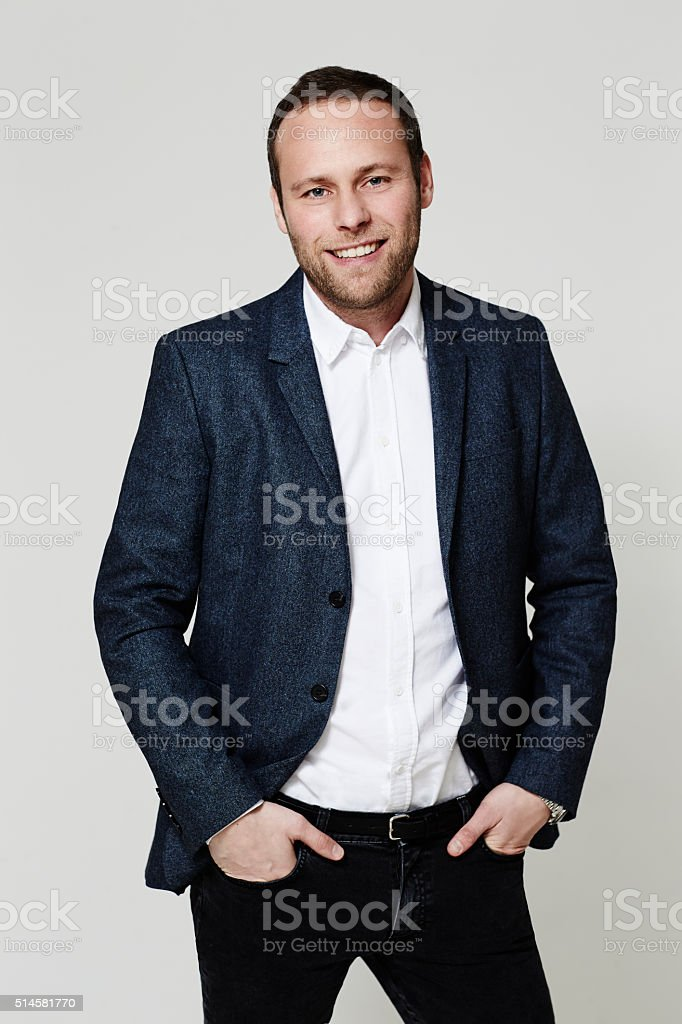 Casual businessman standing in studio stock photo